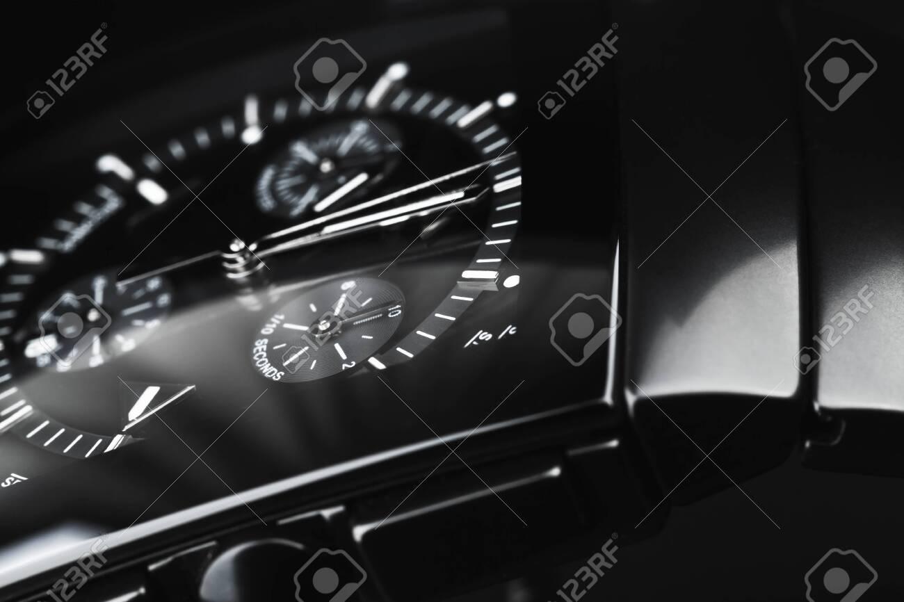 Luxury wrist watch made of black high-tech ceramics. Close-up studio photo with selective focus - 130005601
