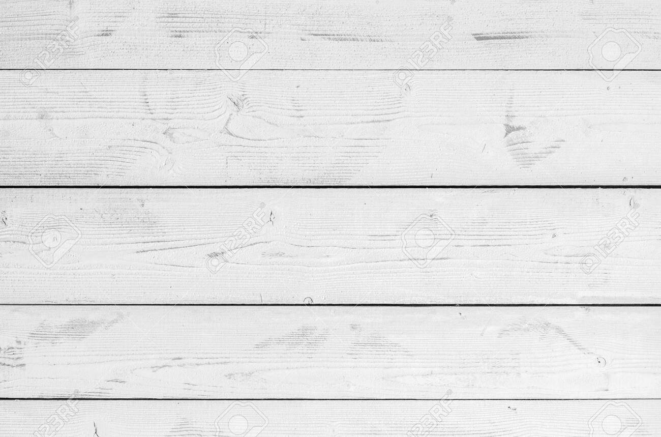 White wooden wall made of flat planks. Frontal background photo texture - 151420030