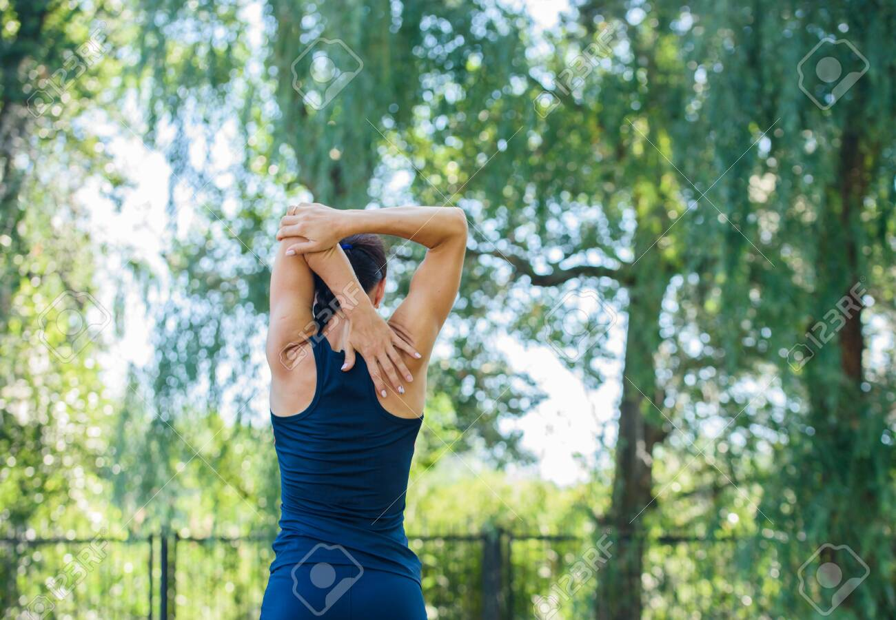 Athletic girl working out in a park. Beautiful embossed back. Health and Sports - 128102282