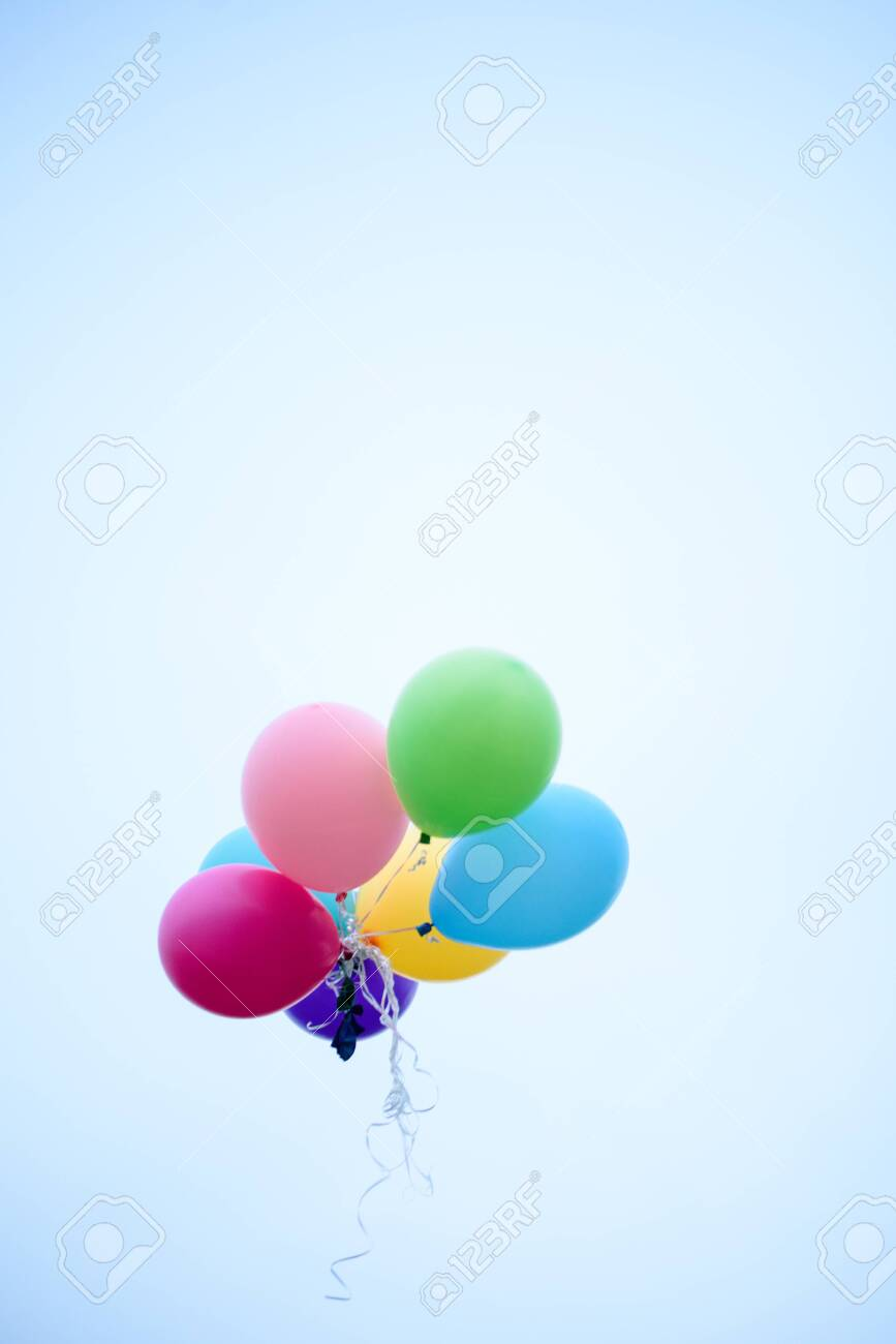 Multi colored balloons flying up in the sky. Holidays - 131287682