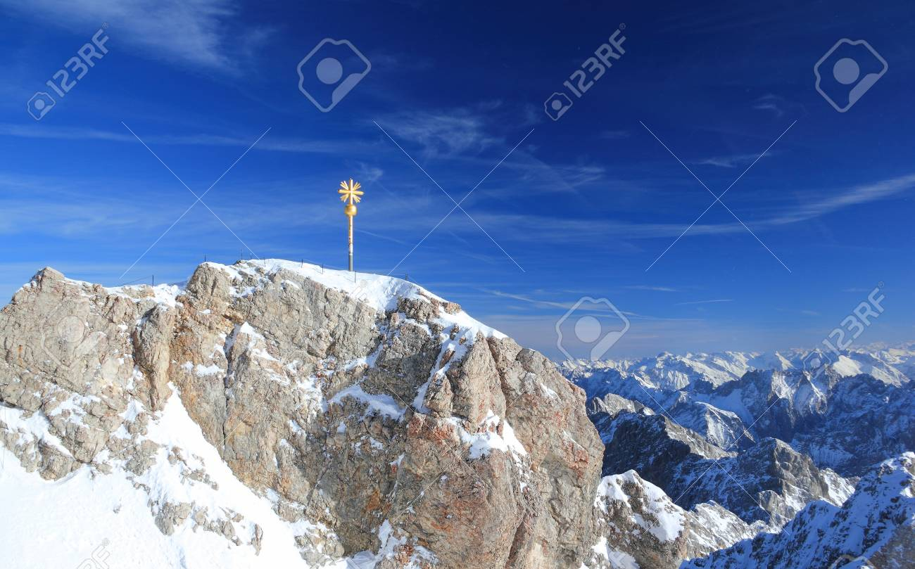Zugspitze mountain - Top of Germany. The Zugspitze, at 2,962 meters above sea level, is the highest mountain in Germany. - 90500485