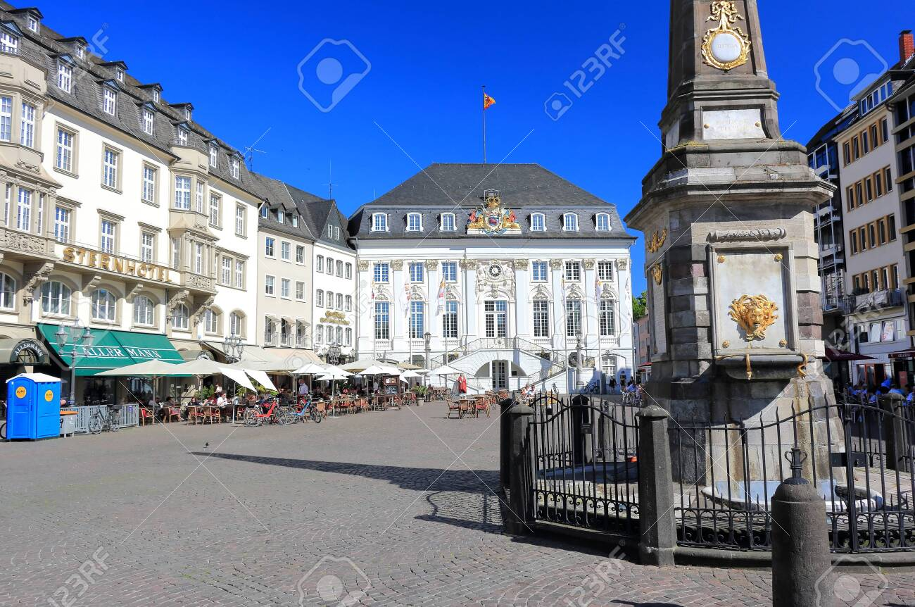 Bonn, Germany – June 11, 2020: Old town hall with unidentified people on a sunny evening in June. It was built in Rococo-style by the court architect M. Leveilly in 1737 - 1738. - 149225556
