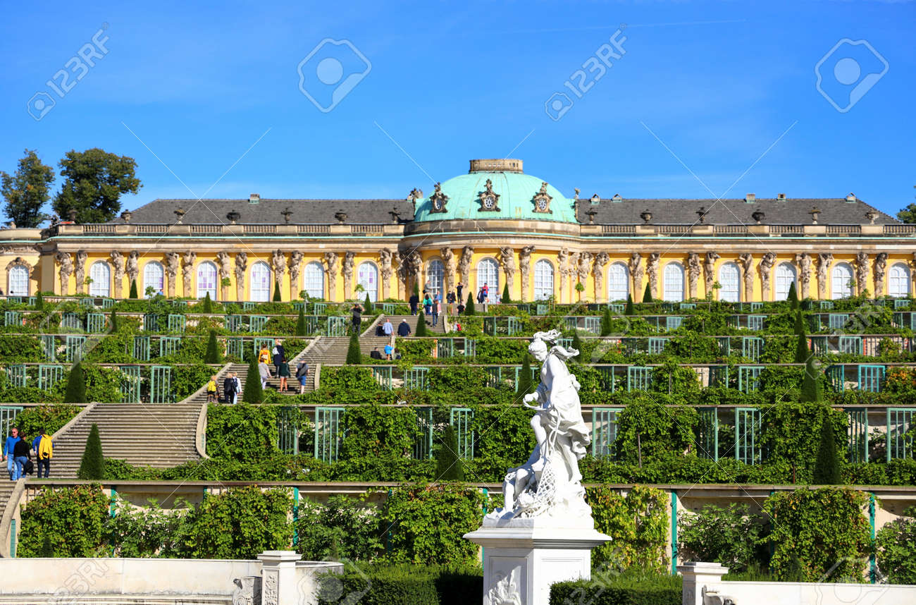 Potsdam, Germany - September 18, 2020: Visiting the royal palace und park Sanssouci in Potsdam on a sunny day in September. View on the the south facing garden façade. - 164924777