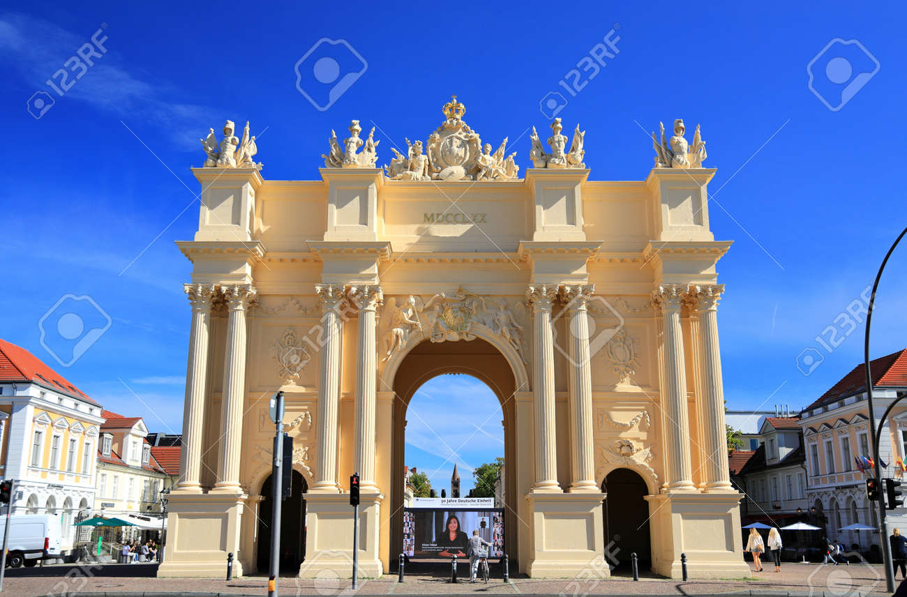 Potsdam, Germany - September 18, 2020: Visiting Potsdam and the Brandenburg Gate on a sunny day in September. View from the field side on the Luisenplatz at the western entrance to the old town. - 163533858