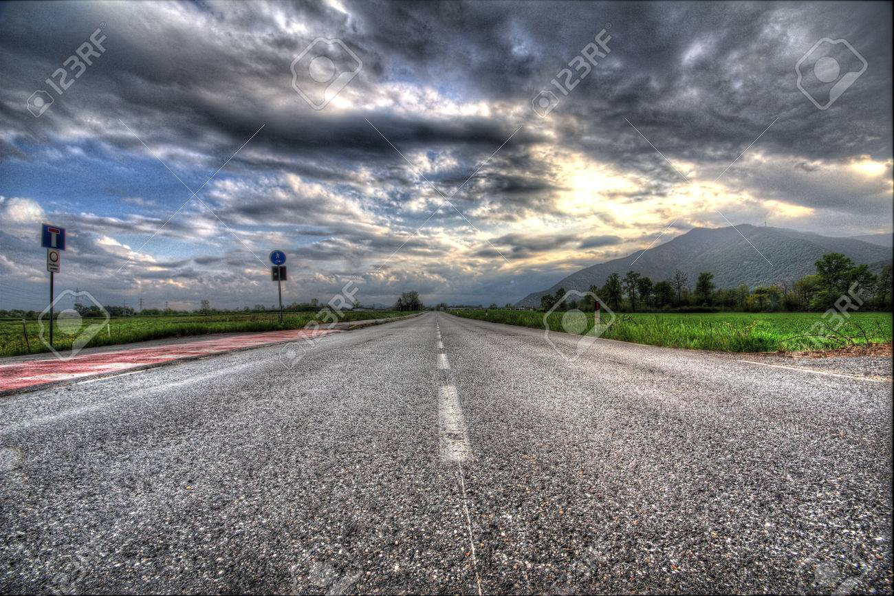 Empty road cloudy sky mountain on background hdr version stock cloudy sky mountain on background hdr version stock photo 59718621 thecheapjerseys Image collections