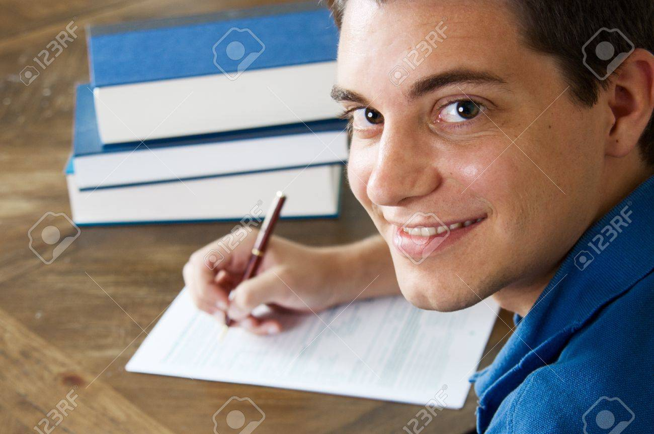 teen boy filling out college application stock photo picture and stock photo teen boy filling out college application