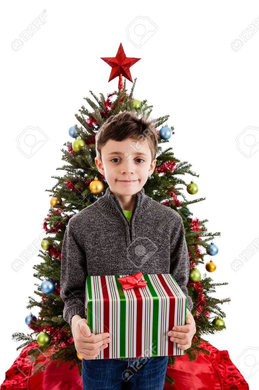 9 Year Old Boy Holding A Wrapped Christmas Present In Front Of ...