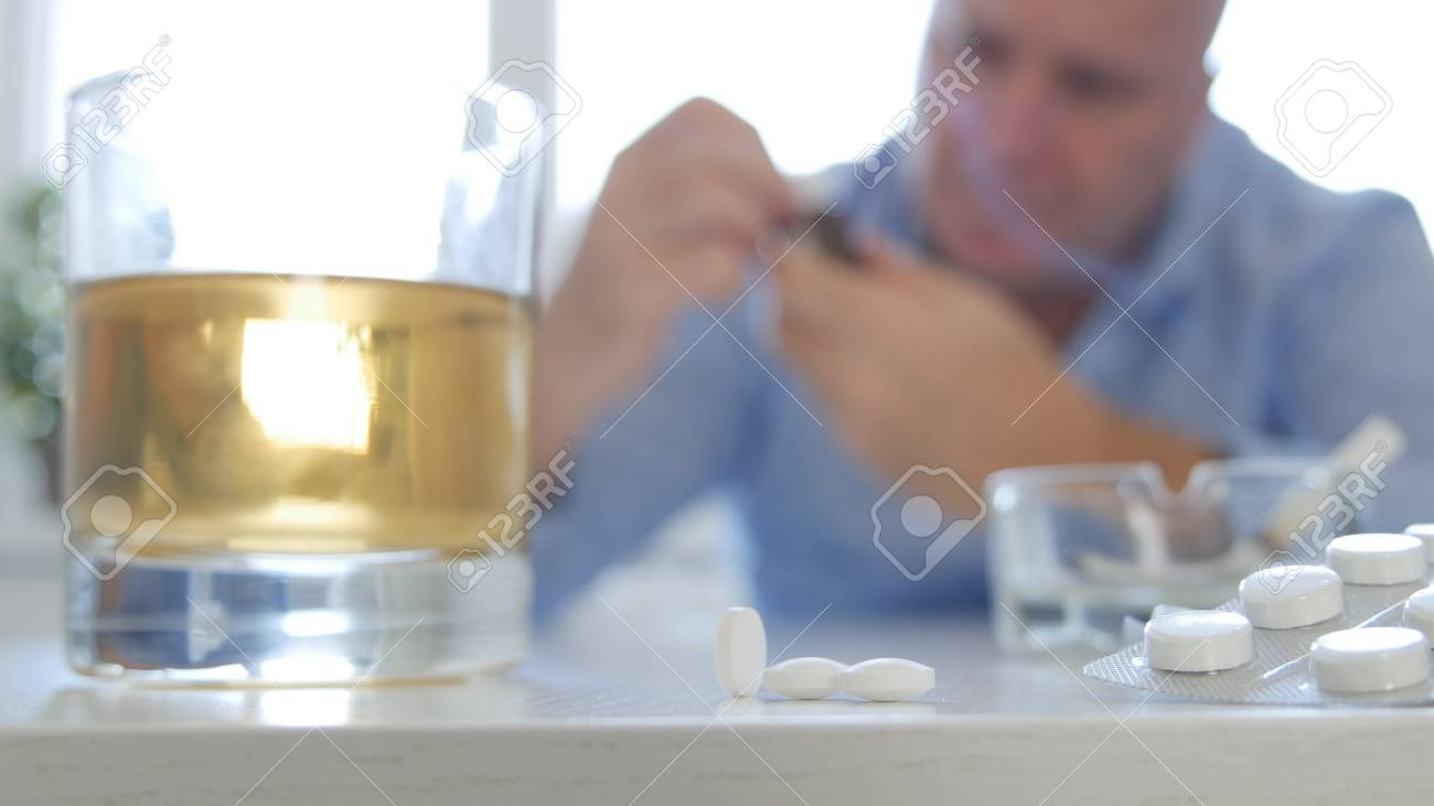 man image making abuse take pills and consume alcohol stock photo