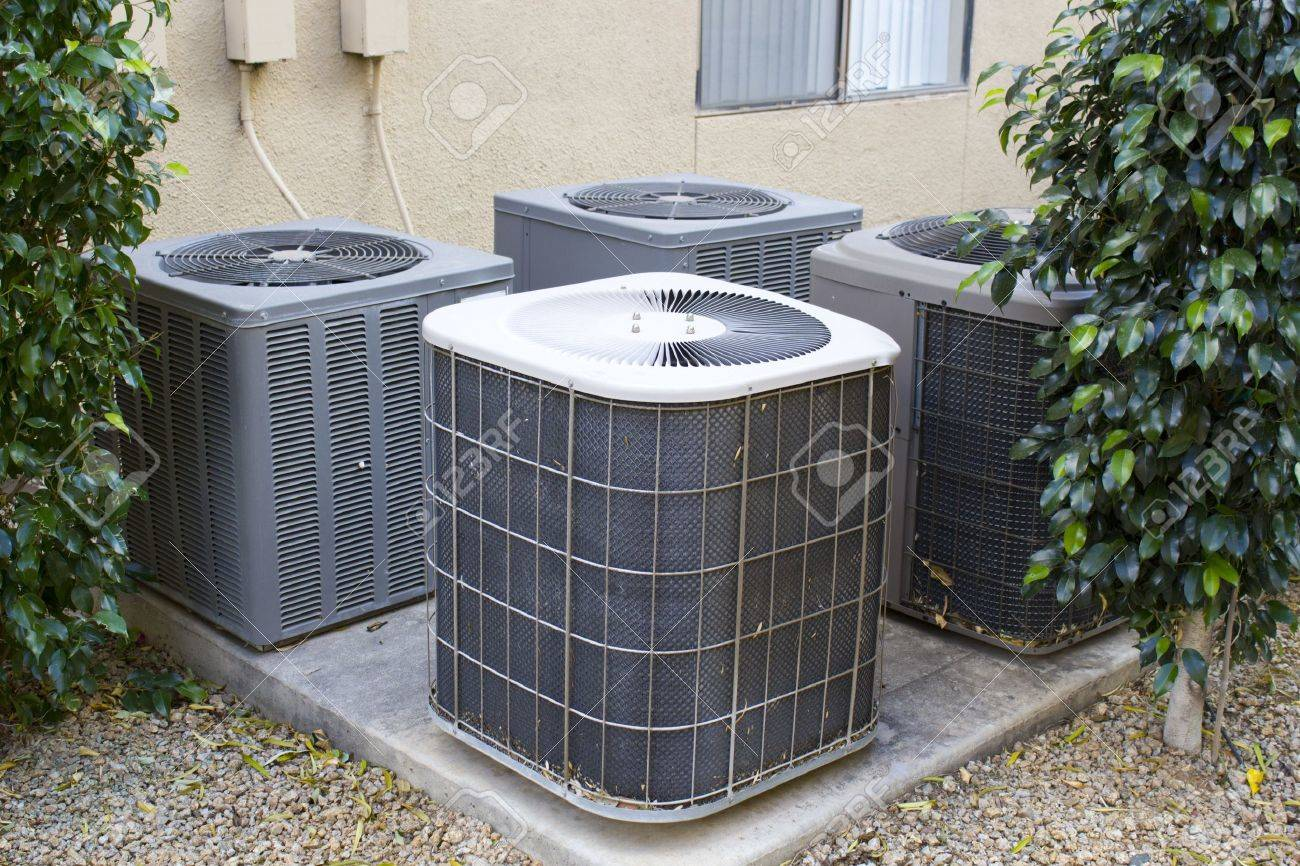residential air conditioner compressor units near building stock