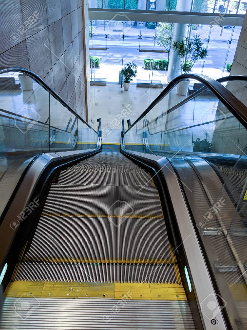 Escalator Moving Staircase Between Street Entrance To A Shopping Mall And  Next Floor Level Stock Photo