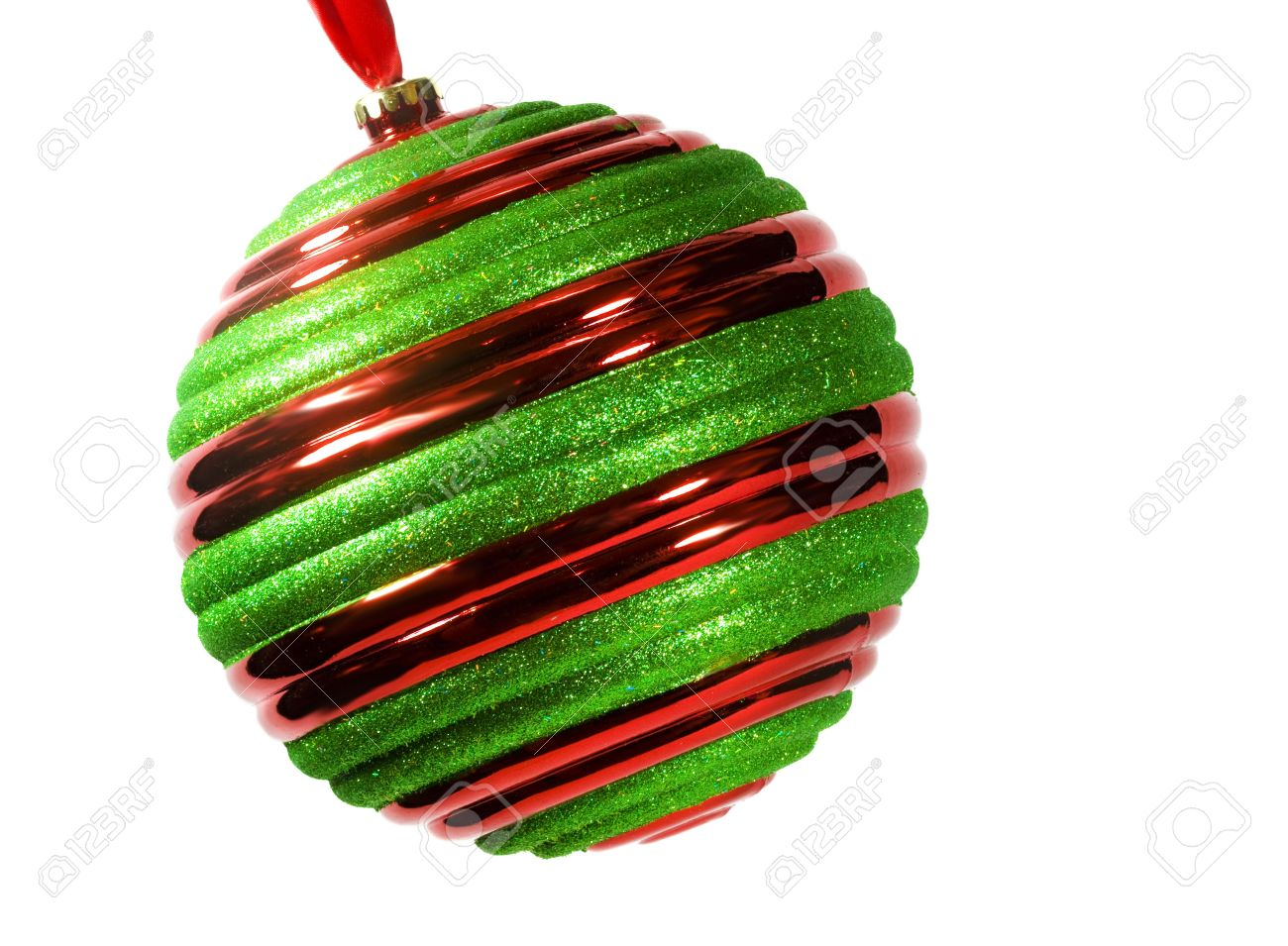 Red And Green Striped Christmas Ornament Hanging From Red Ribbon, Tipped On  Diagonal, Isolated