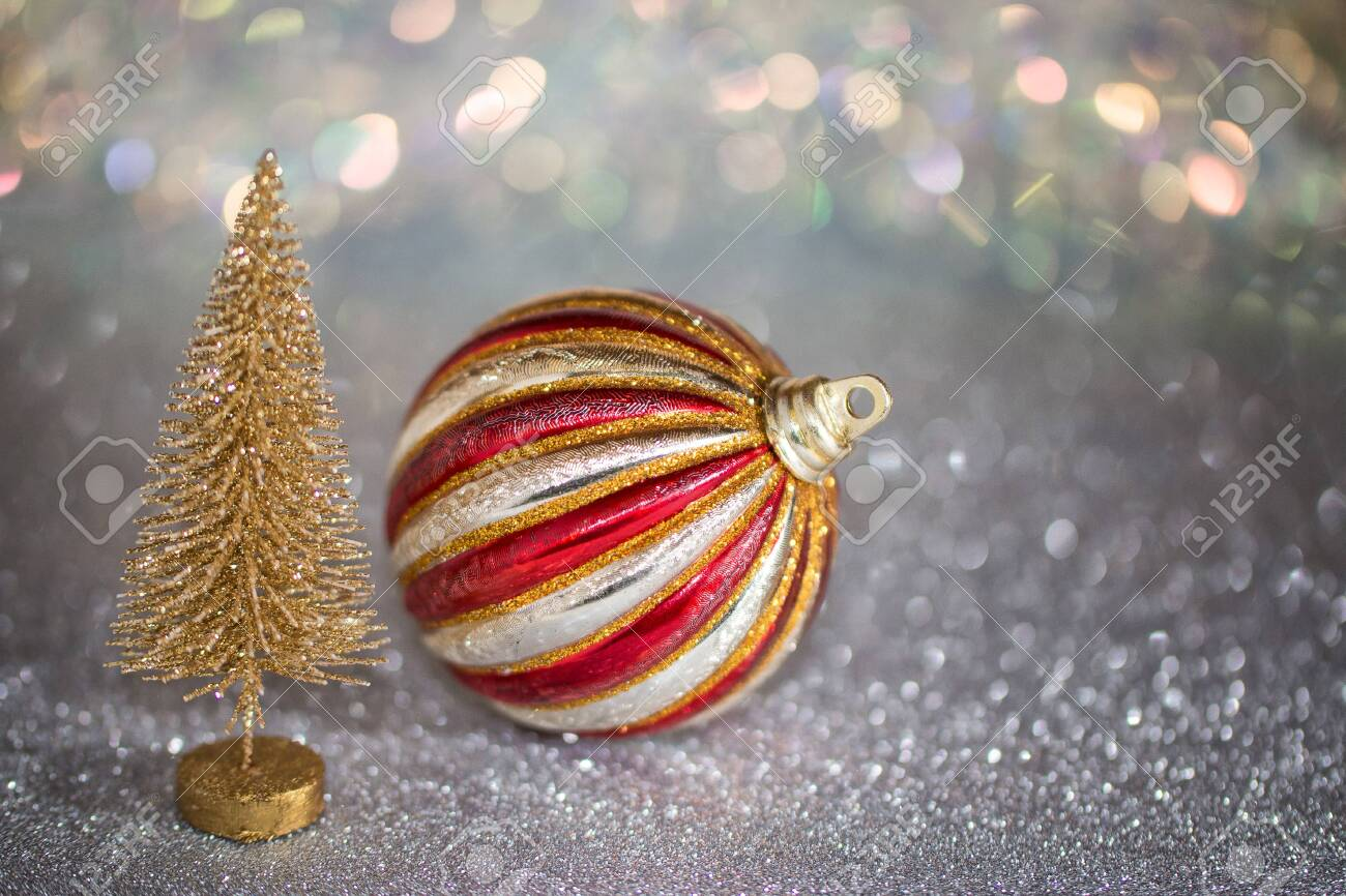 Small Gold Christmas Tree And Red And Silver Striped Christmas Stock Photo Picture And Royalty Free Image Image 134593325