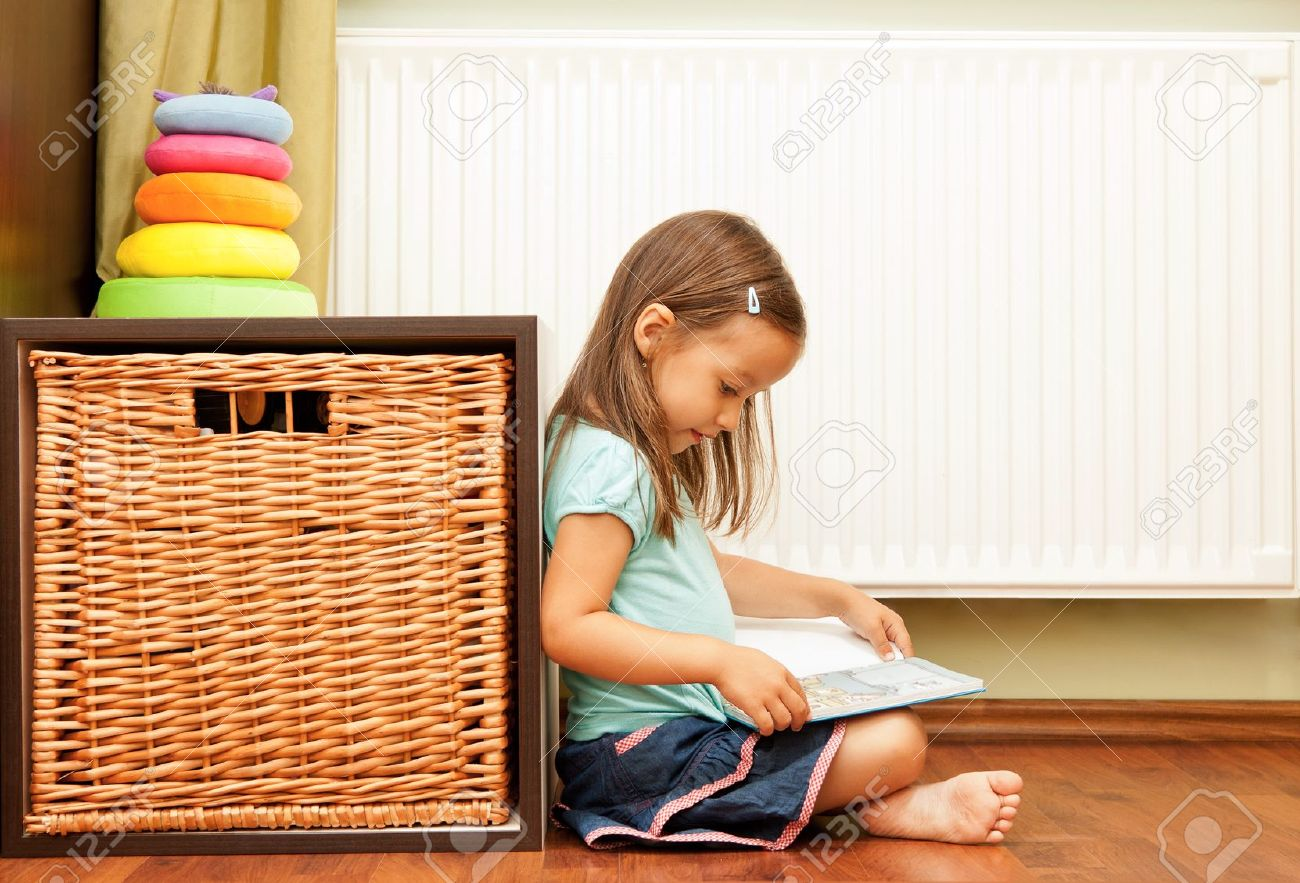 little girl reading a book Stock Photo - 10467774