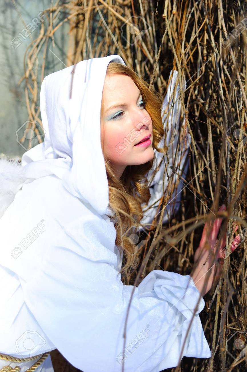 Blond beautiful girl wearing white fleece hood Stock Photo - 6631623