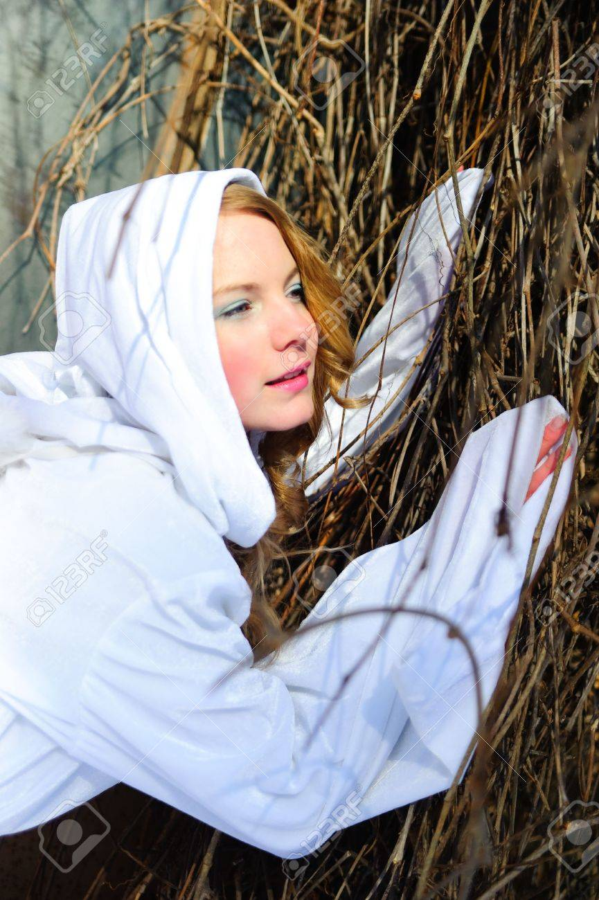 Blond beautiful girl wearing white fleece hood Stock Photo - 6631614