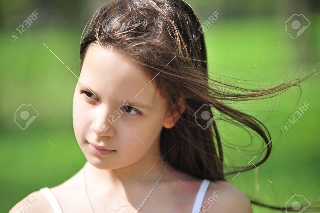 Portrait of the little girl with long hair looking aside Stock Photo - 7113392