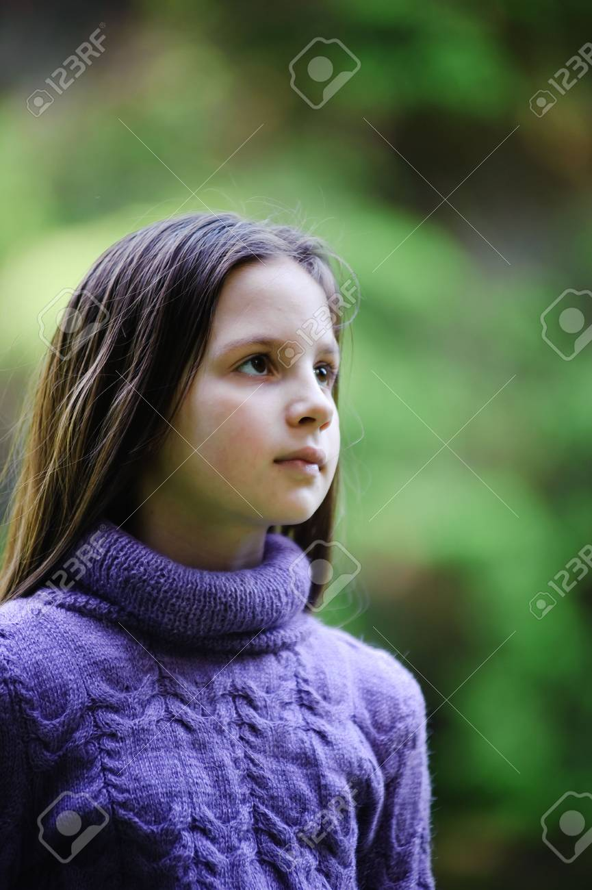 Portrait of the little girl with long hair looking aside Stock Photo - 7156440