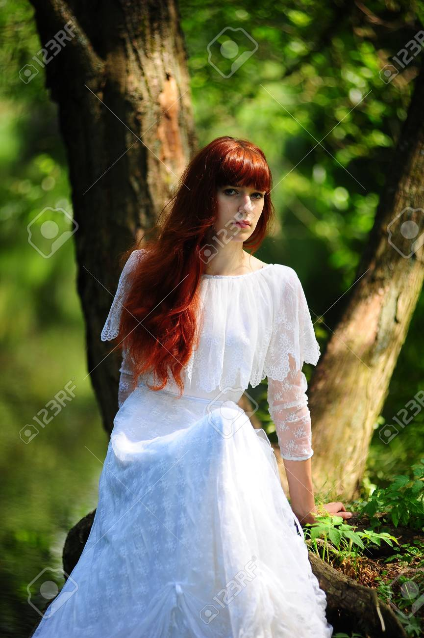 Young red-haired pretty woman on the summer park Stock Photo - 7539517