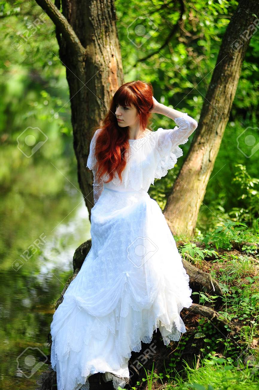 Young red-haired pretty woman on the summer park Stock Photo - 7539531