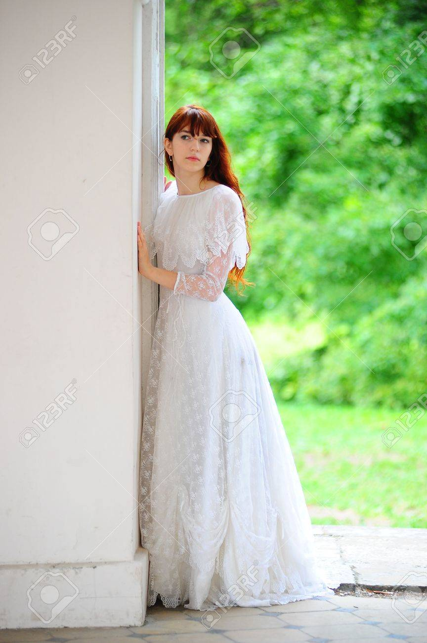 Portrait of a beautiful young victorian lady in white dress Stock Photo - 8195000