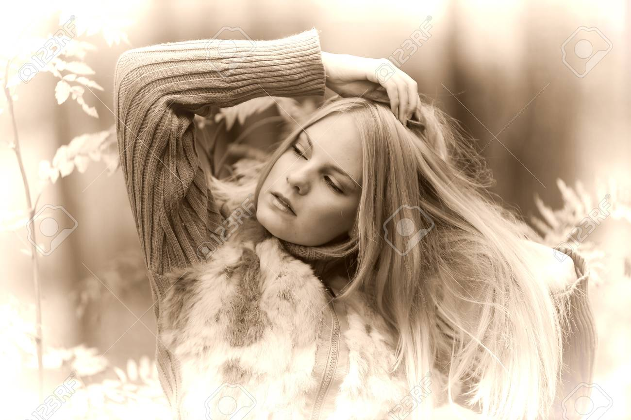 beautiful young woman in autumn park Stock Photo - 8419877