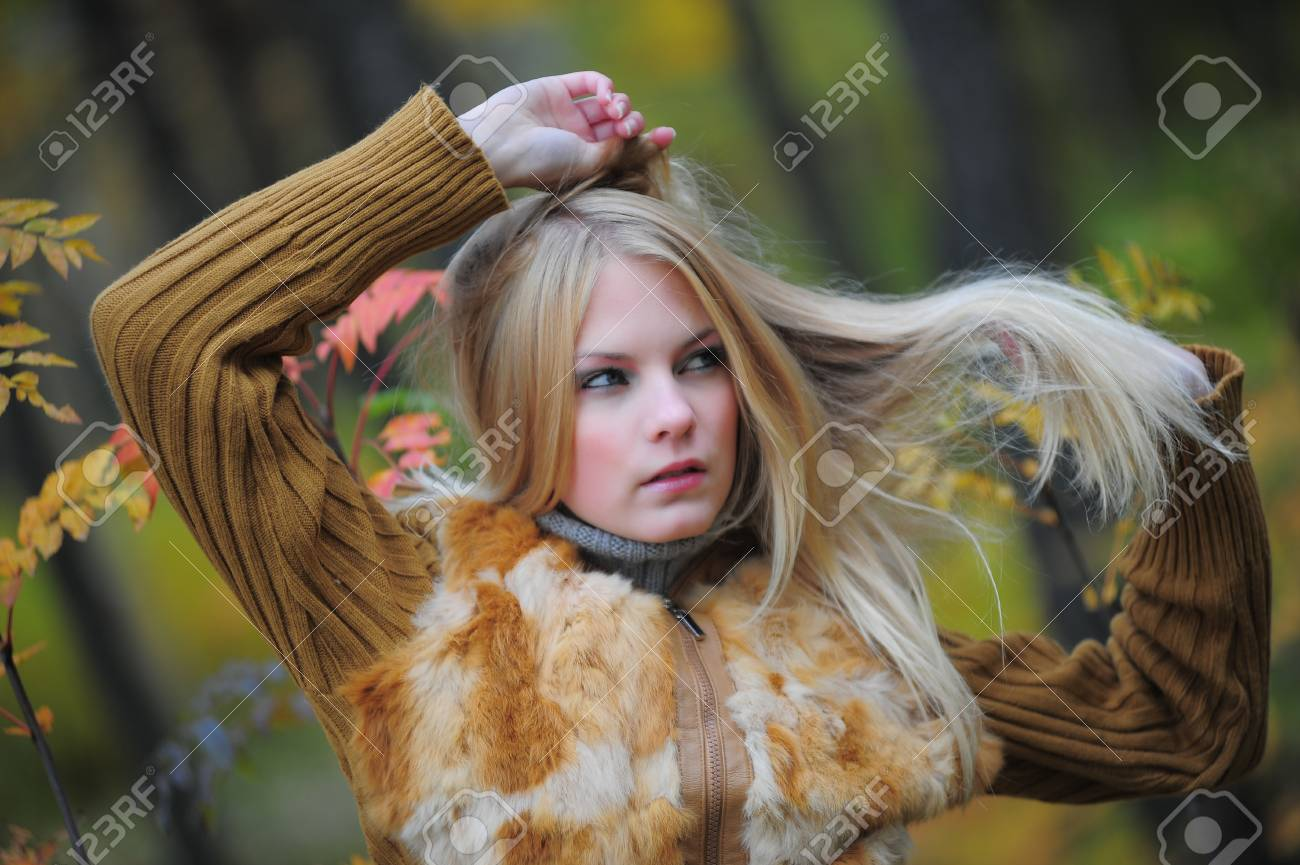 beautiful young woman in autumn park Stock Photo - 8419857