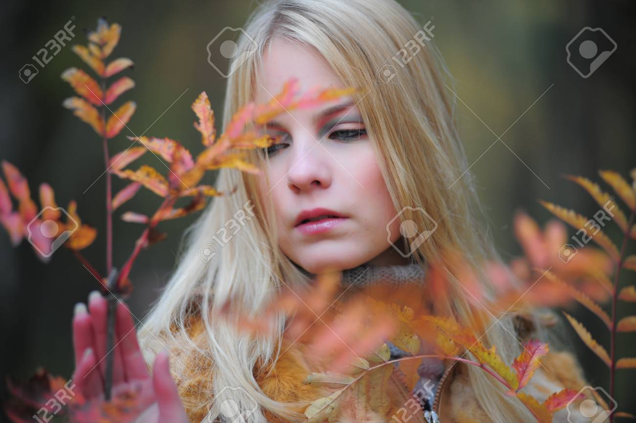 beautiful young woman in autumn park Stock Photo - 8419790