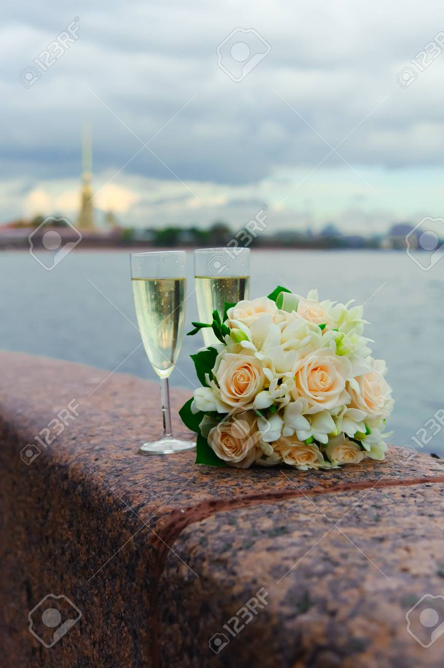 glasses of champagne and a bouquet Stock Photo - 8361664