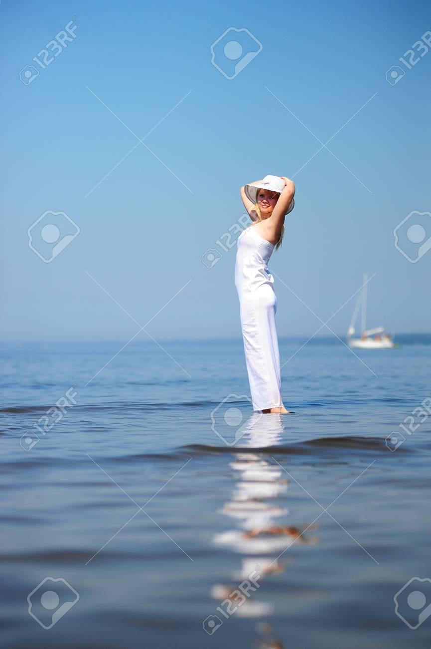 girl in white dress in the sea Stock Photo - 9724513