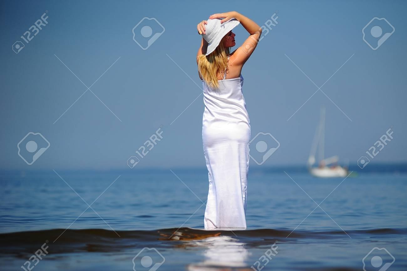 girl in white dress in the sea Stock Photo - 9724511
