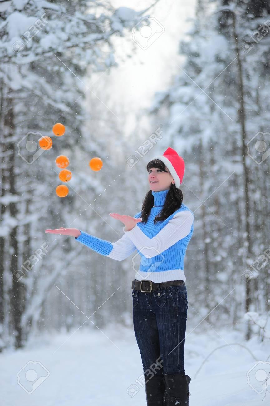 girl juggling oranges Stock Photo - 8715424