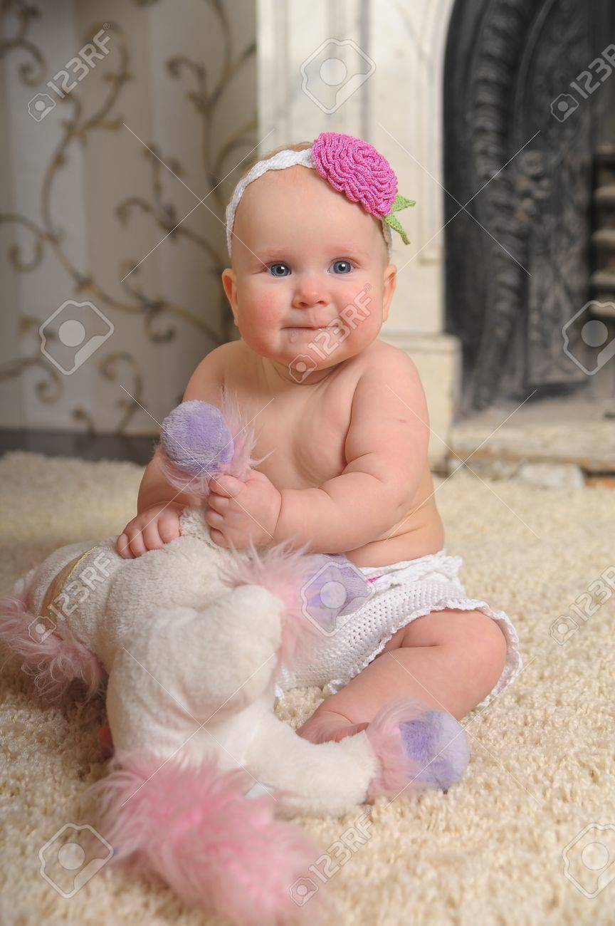 Portrait of 6 months baby girl isolated on white Stock Photo - 8703560