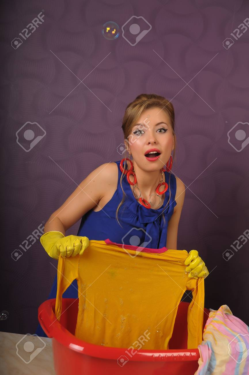 Housewife wash clothes in the basin. Photo taken in the pin up Stock Photo - 8660348