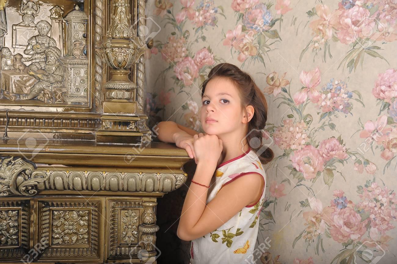 girl with retro hairdo about antique stove Stock Photo - 13728015