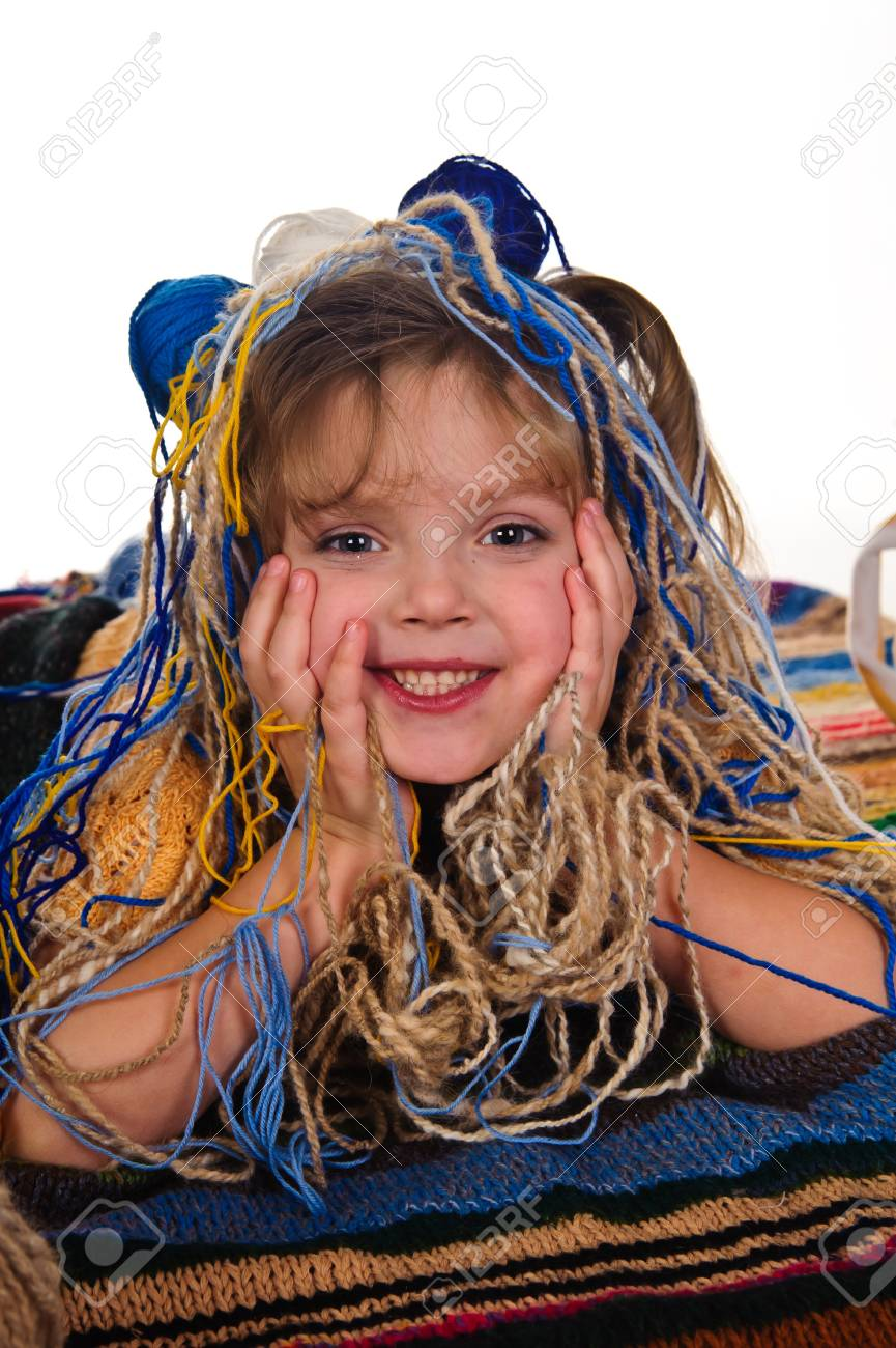 little girls play with balls of wool Stock Photo - 8934677