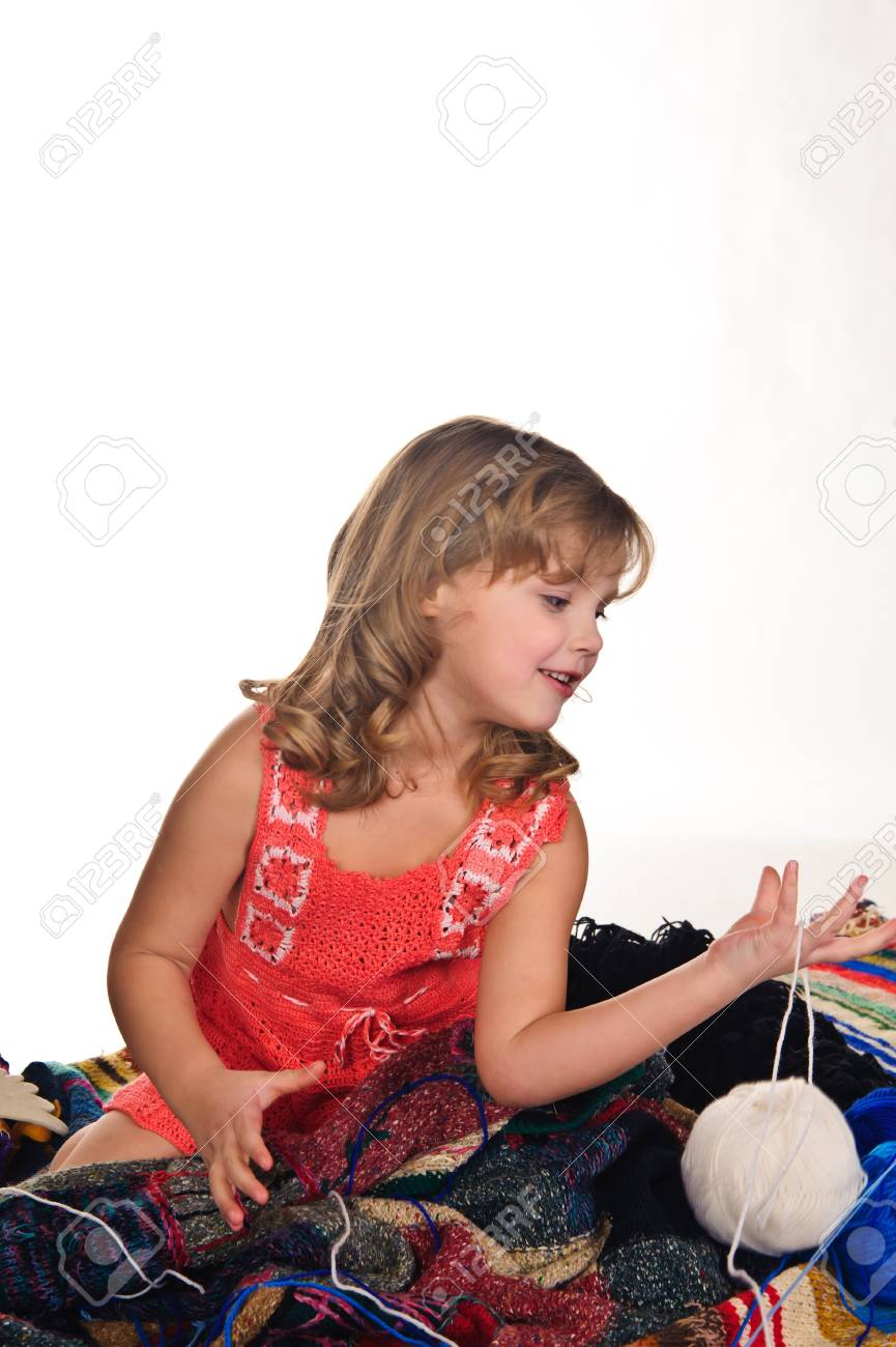 Girl playing with balls of wool Stock Photo - 9238844