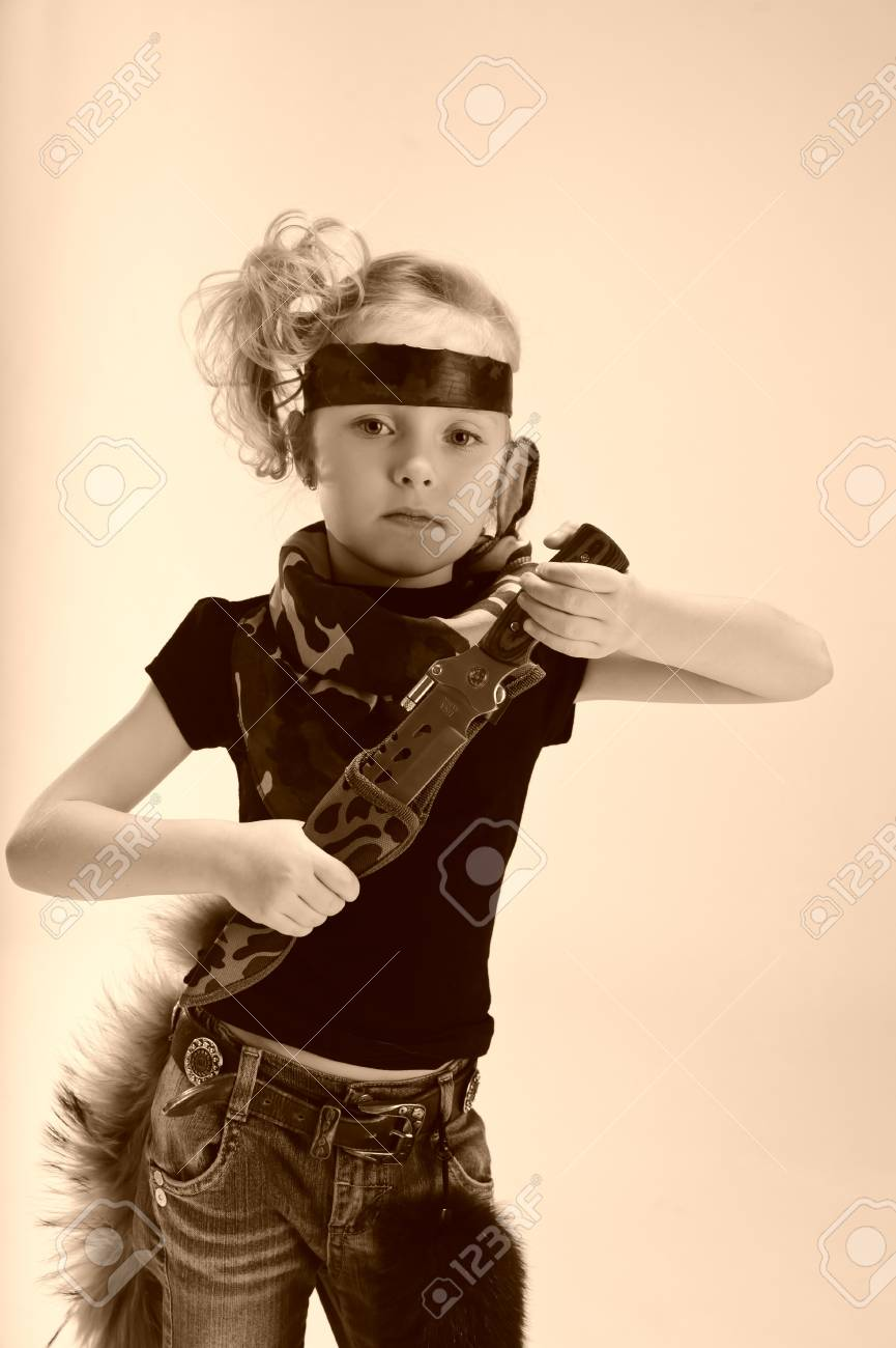 toddler girl with an army knife Stock Photo - 9045488