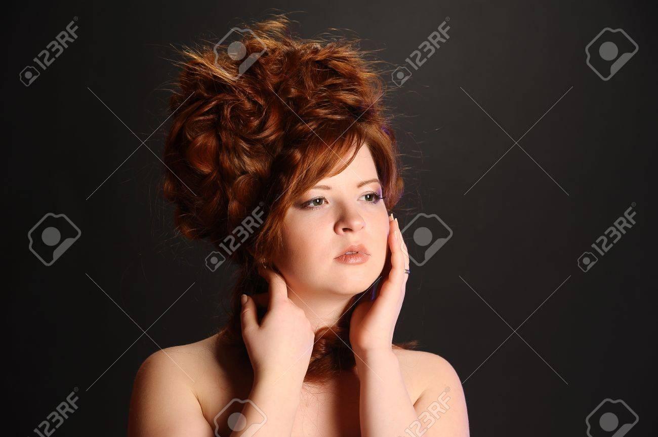 The elegant red-haired girl in studio Stock Photo - 11972480