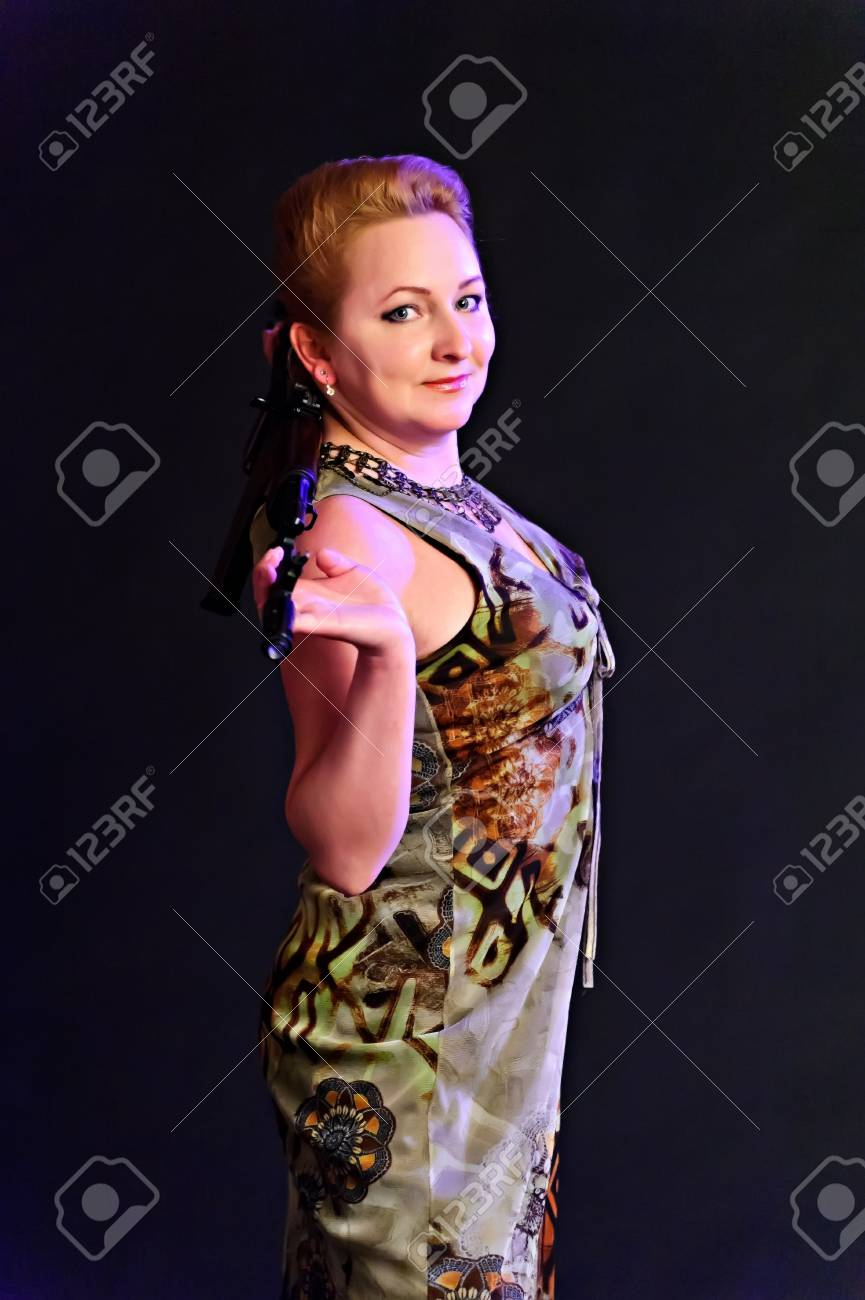 middle-aged woman with a gun Stock Photo - 10833557
