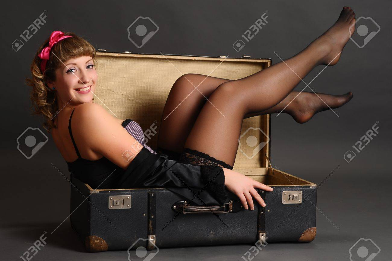 bin up girl in a suitcase Stock Photo - 9266868