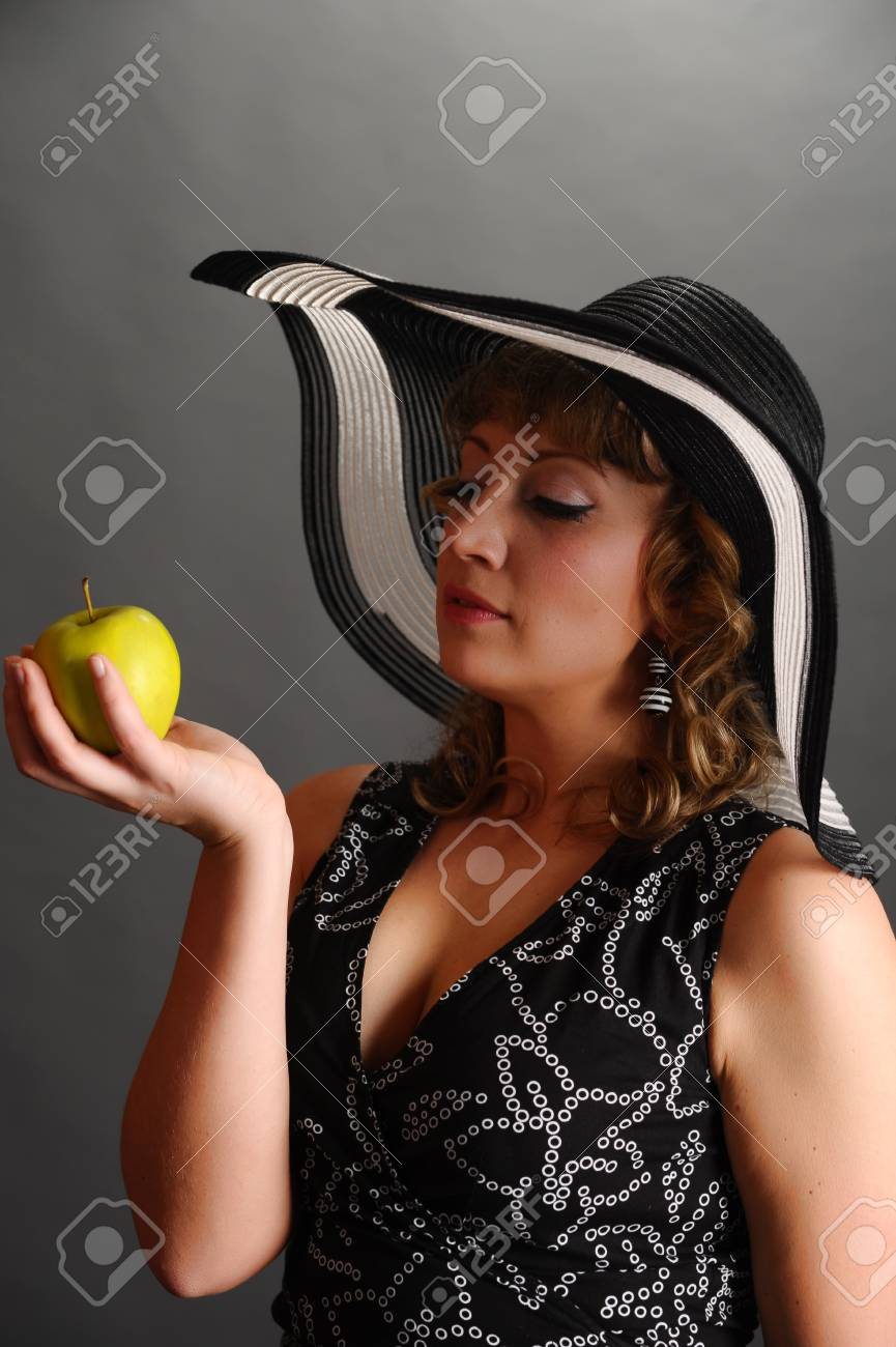 girl in a hat with an apple Stock Photo - 9266820
