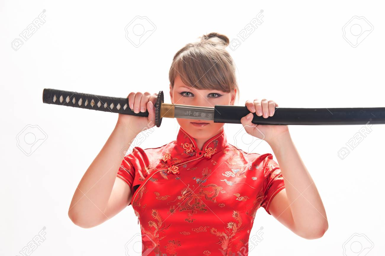 girl in a red dress with a katana Stock Photo - 9328129