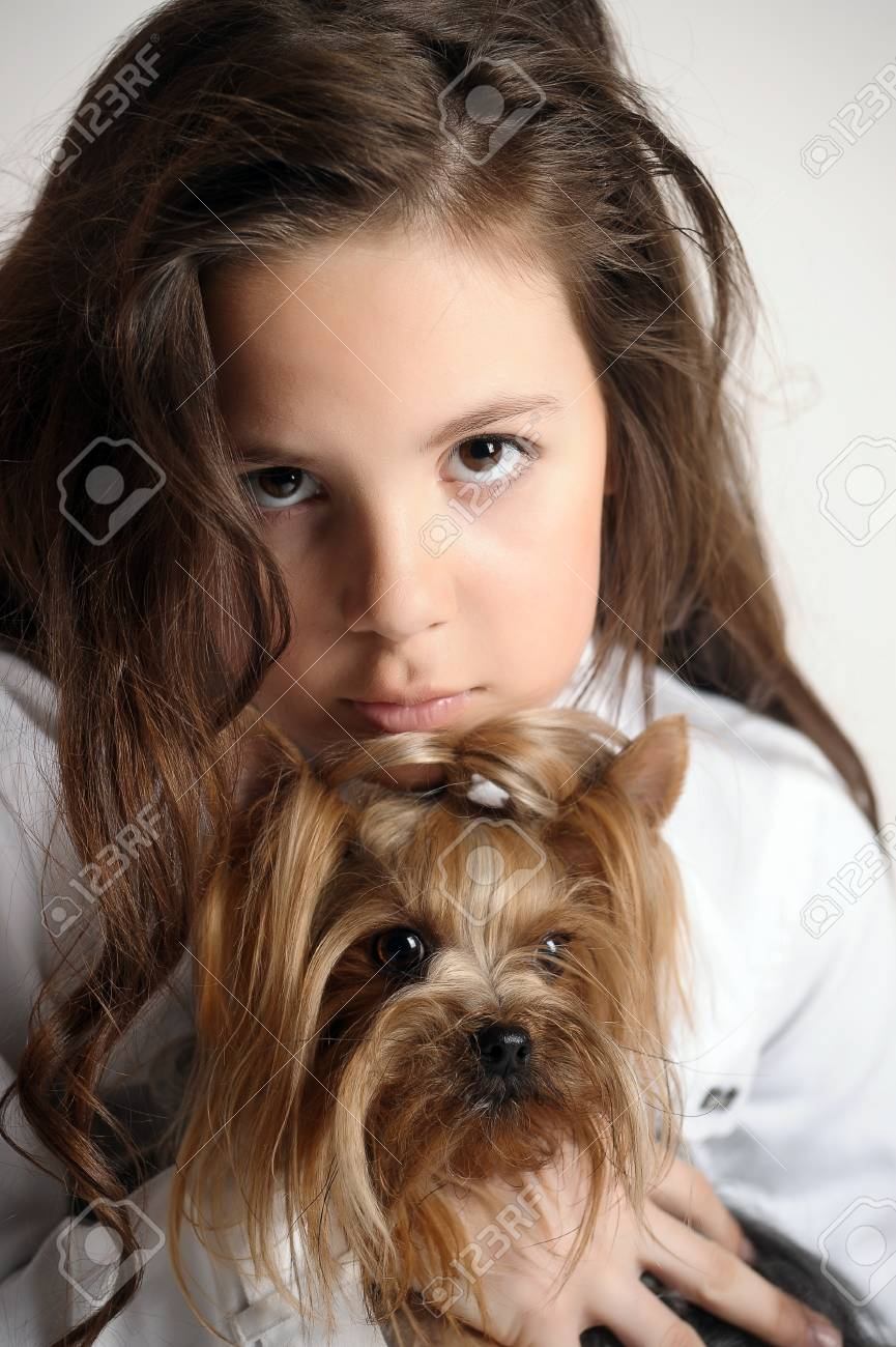 Girl with a Yorkshire terrier Stock Photo - 9403861