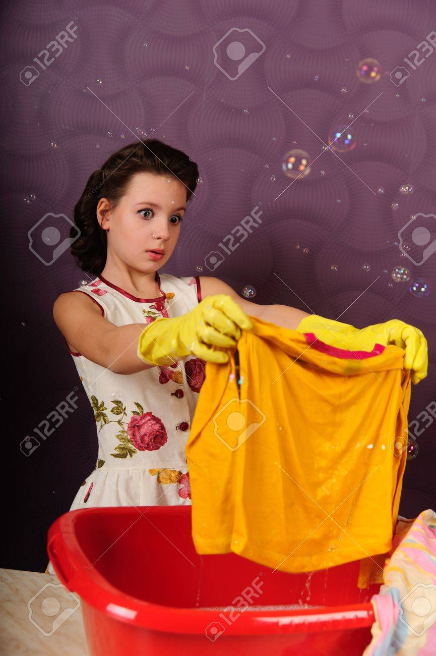 Girl wash clothes in a bucket Stock Photo - 9372331