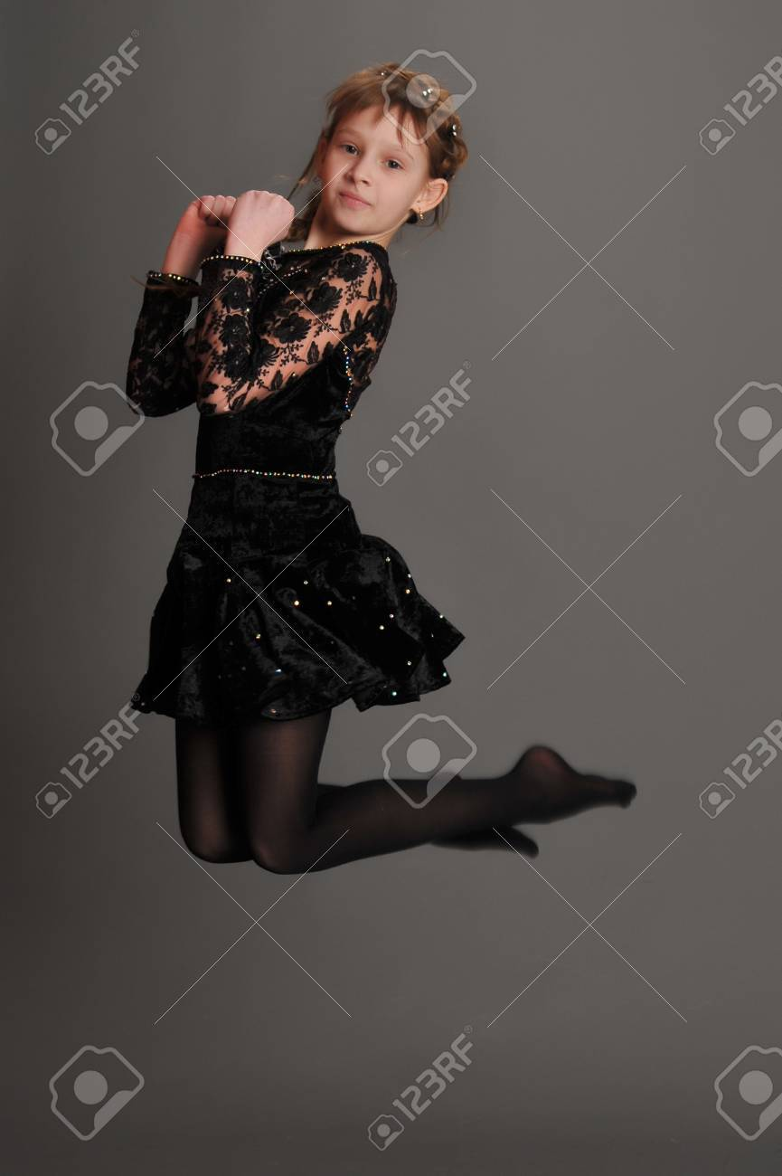 girl jumping high in the studio on a gray background Stock Photo - 9445342