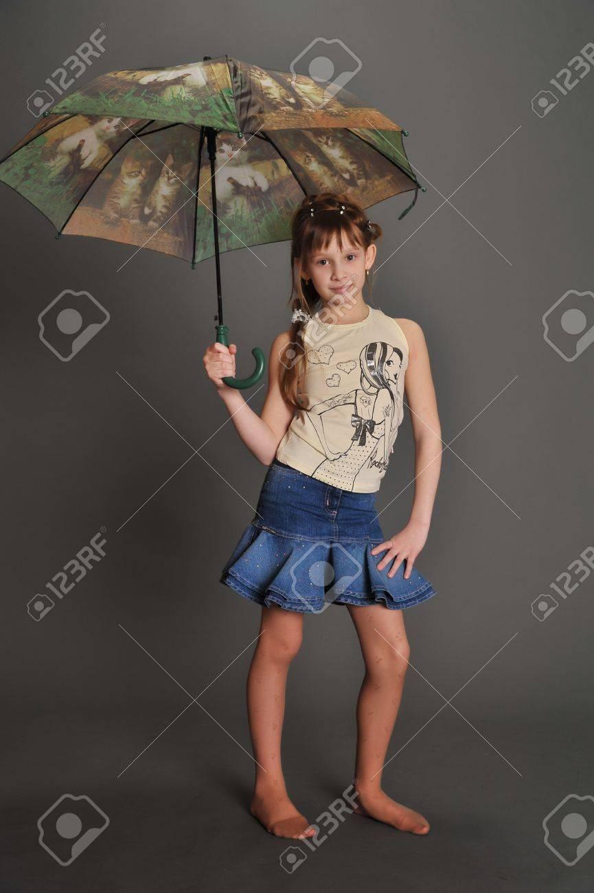 Girl umbrella studio Stock Photo - 9381519