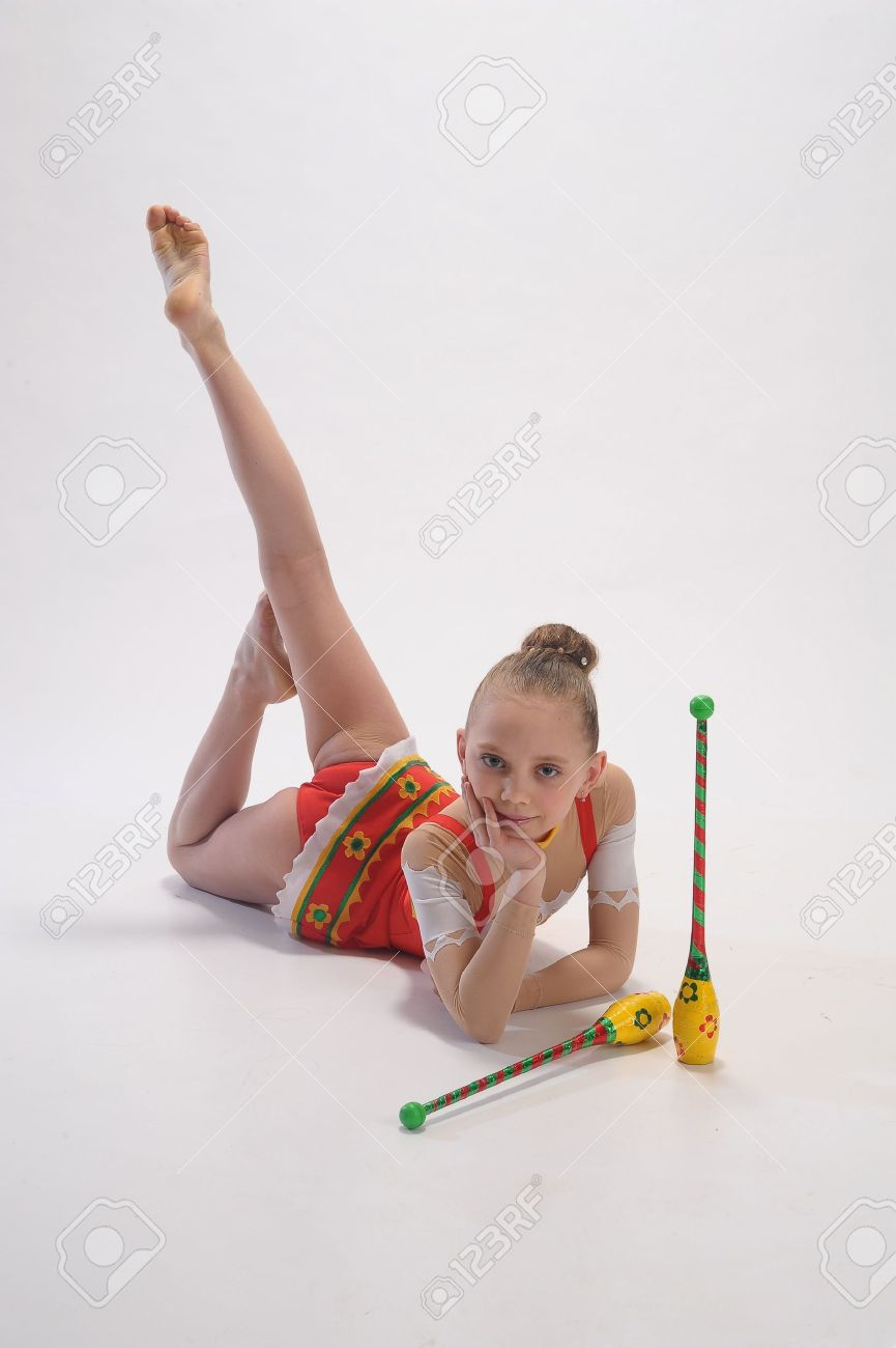 gymnastic girl Girl gymnast with clubs Stock Photo - 9416195
