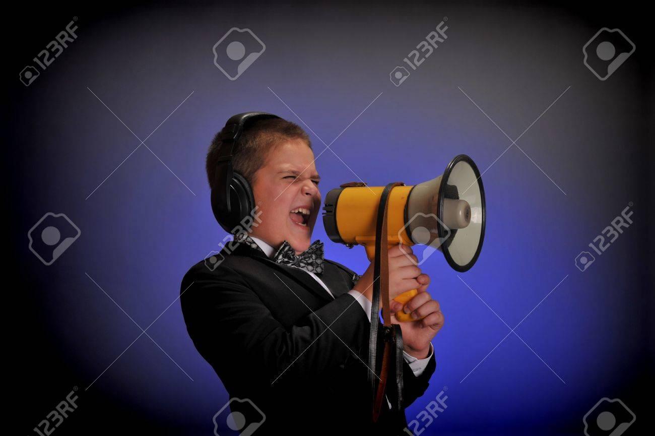 boy screaming at the loudspeaker Stock Photo - 9415350