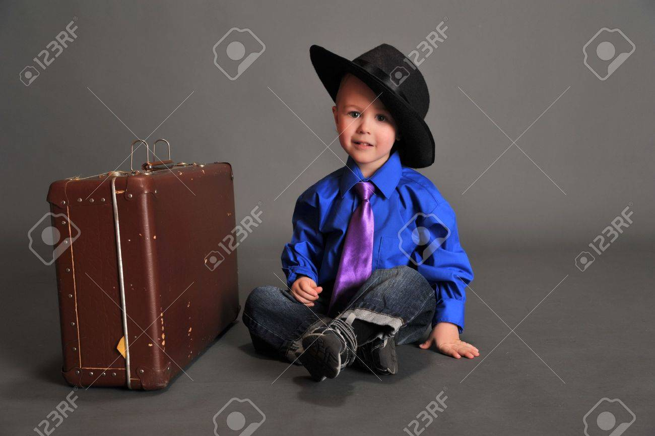 boy and an old suitcase Stock Photo - 10747225