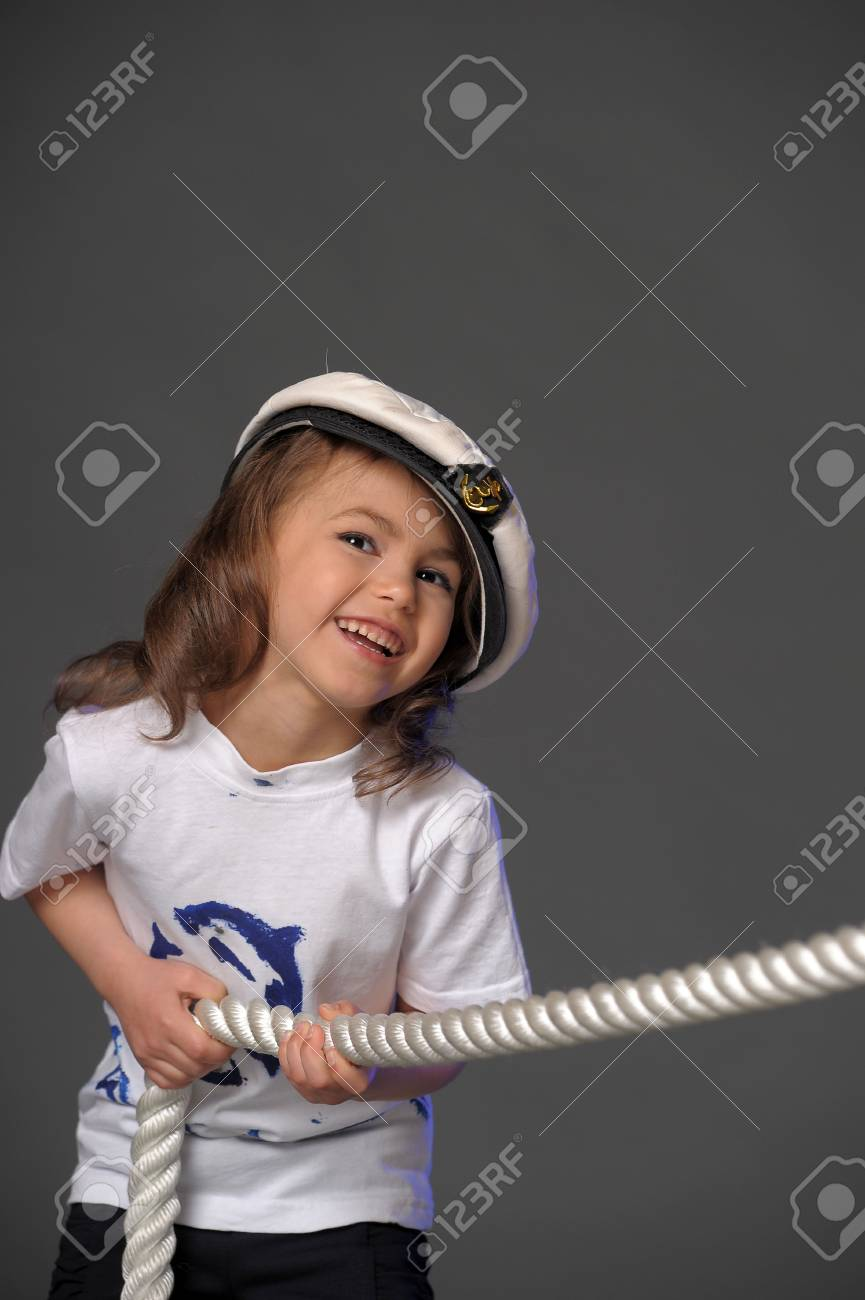 a young sailor with rope Stock Photo - 9578176